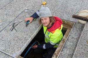 Man Installing Underground Wiring for Midland Junction